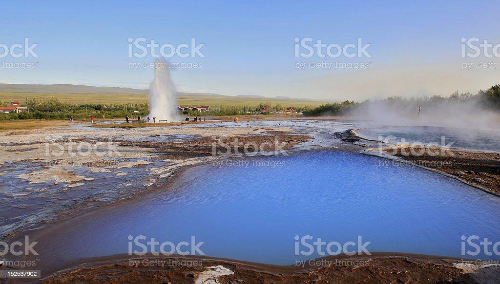 Strokkur Geysir Erupting and Blesi Pool, Iceland stock photo