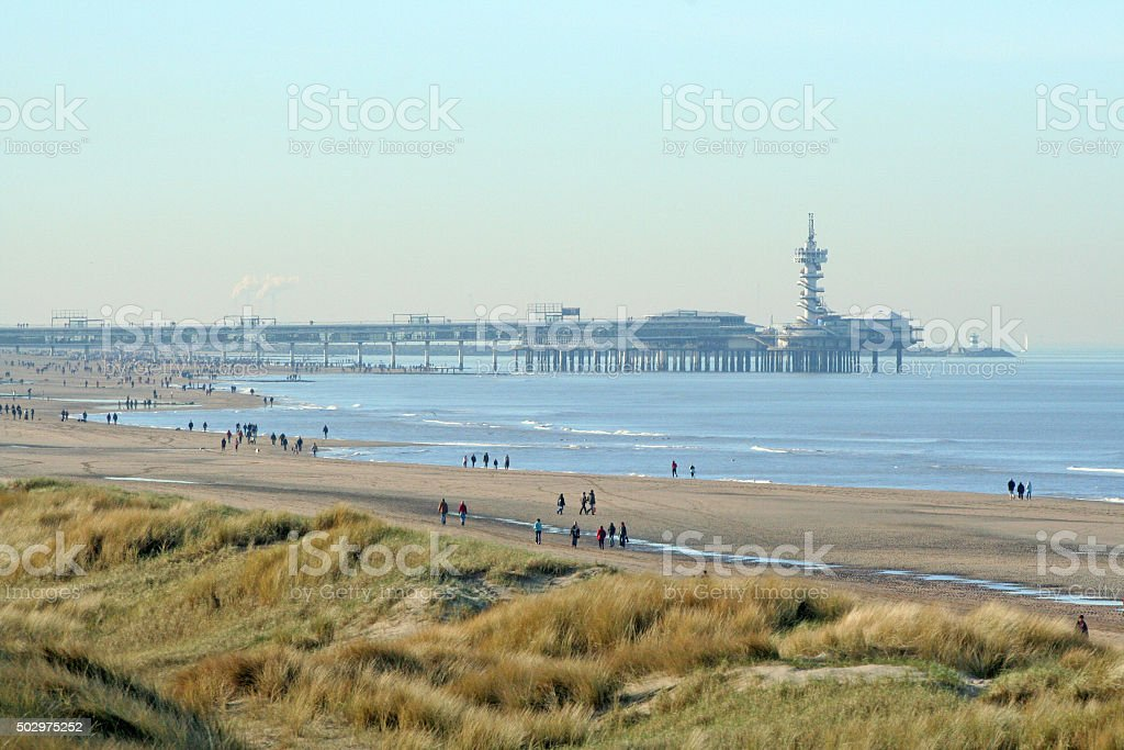 Stroling on the beach on a sunny winter morning stock photo
