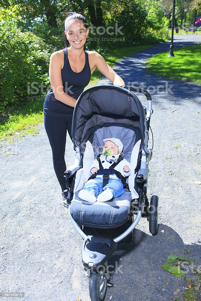 Stroller Mother with Baby stock photo