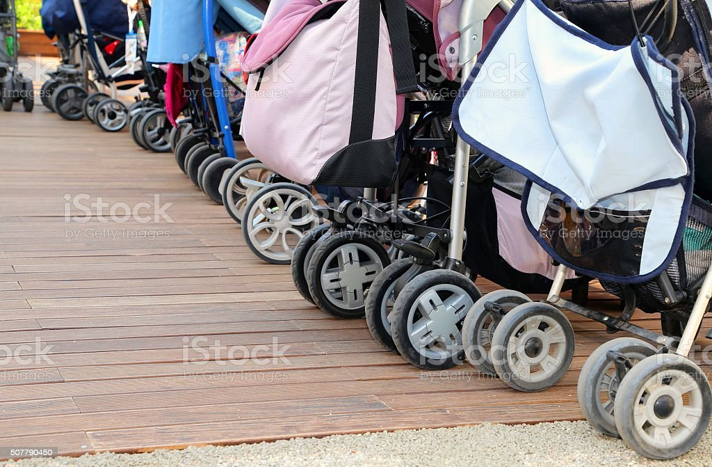 strollers parked on the parquet floor stock photo