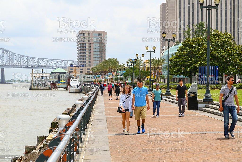 Strolling down New Orleans Riverwalk stock photo