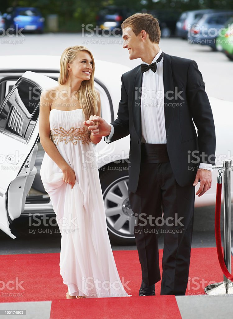 Strolling down the red carpet together royalty-free stock photo