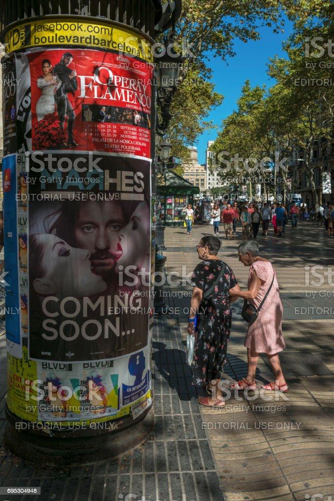 Strolling through La Rambla in Barcelona stock photo