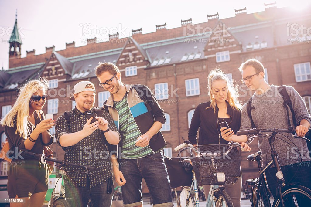 Strolling through the city with friends stock photo