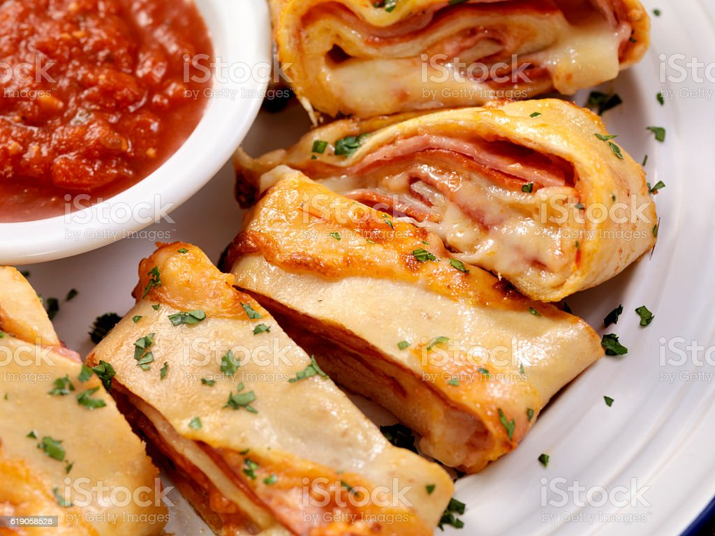 Stromboli with Pepperoni and Ham and Salami stock photo