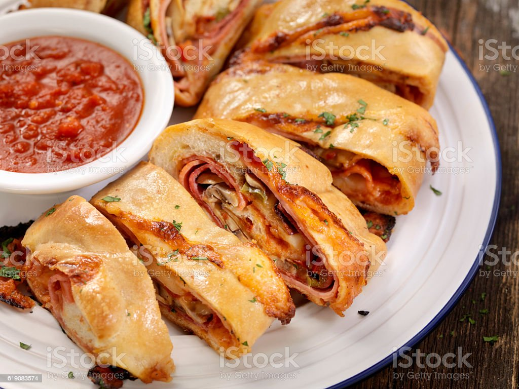 Stromboli with Pepperoni, Salami, Mushrooms and Peppers stock photo