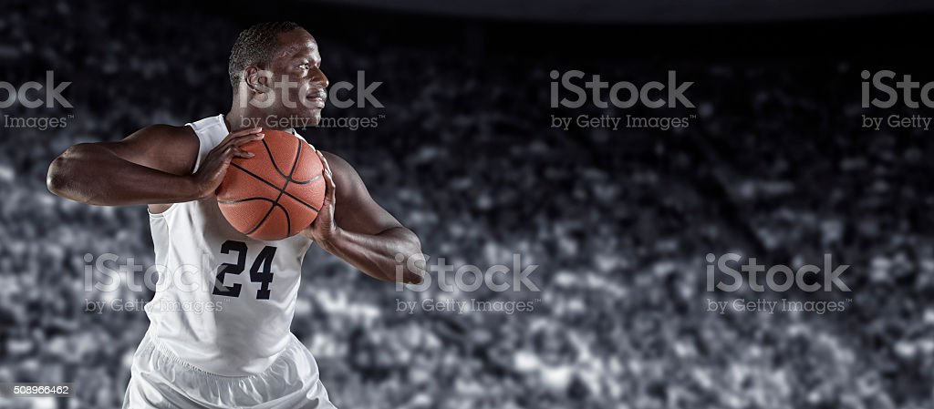 Strong African american basketball player in a basketball arena stock photo
