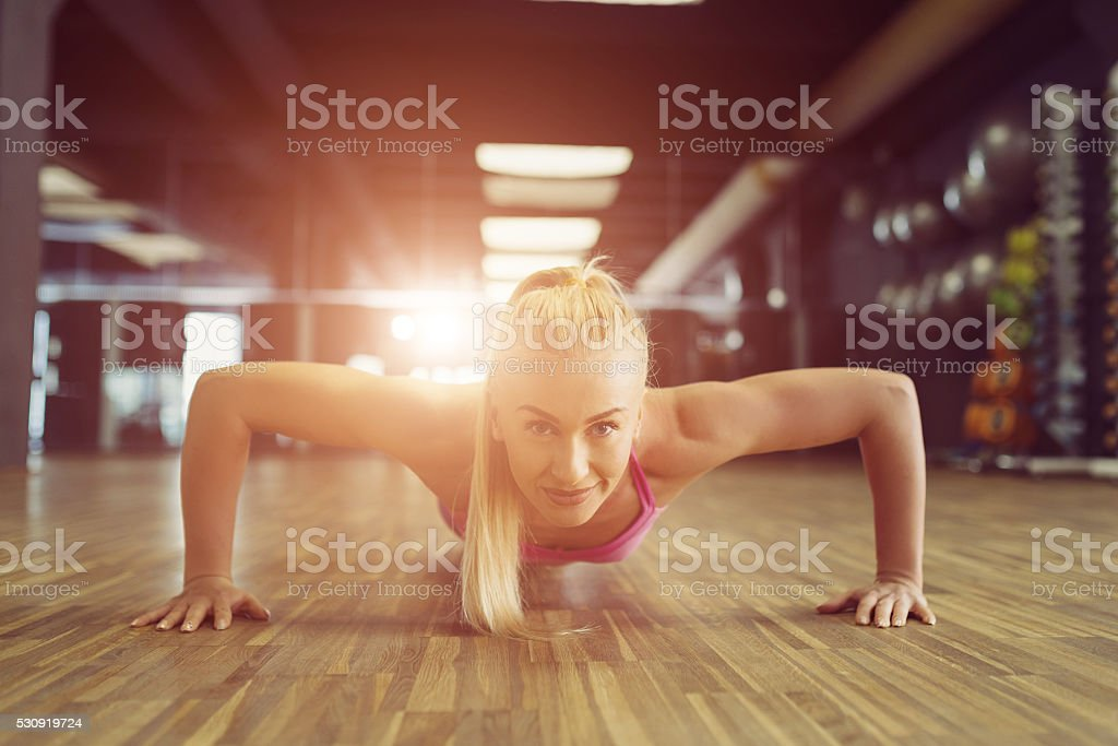 Strong and beautiful athletic woman training in the gym stock photo