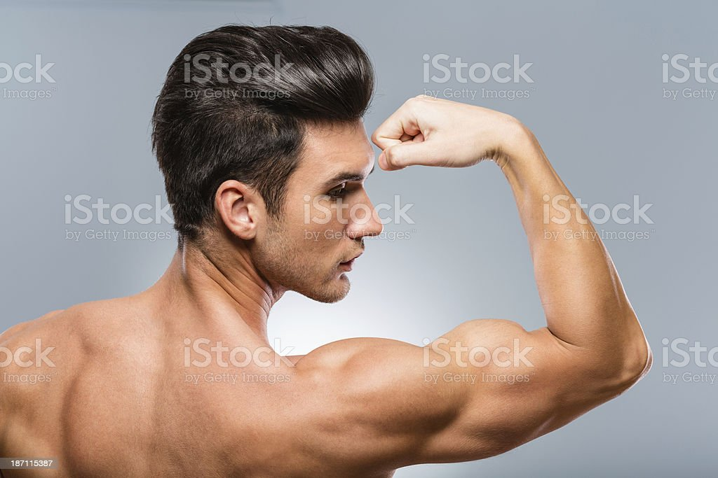 Strong and healthy man showing muscles royalty-free stock photo