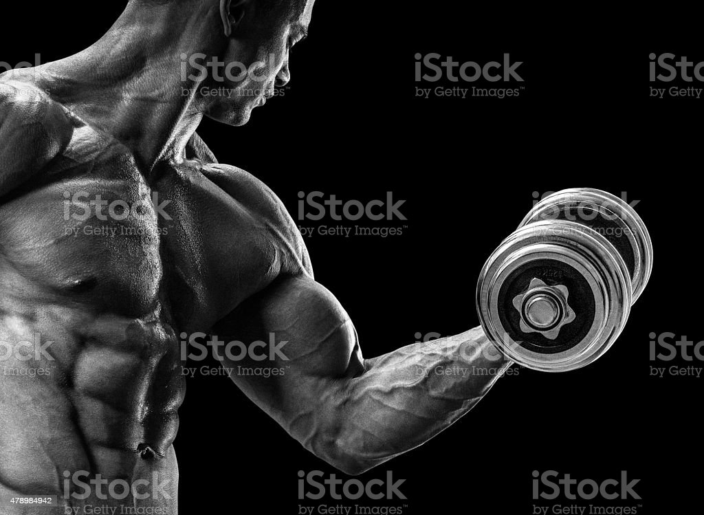 Strong and power bodybuilder doing exercises with dumbbell stock photo