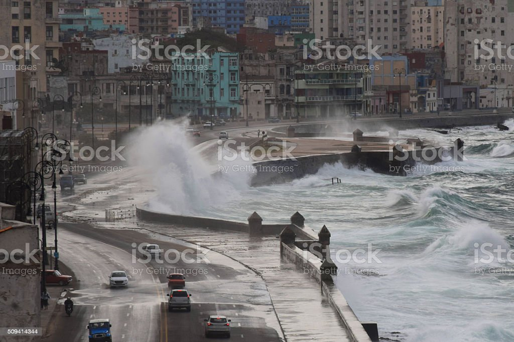 Strong and rough waves hit the shore in the city stock photo