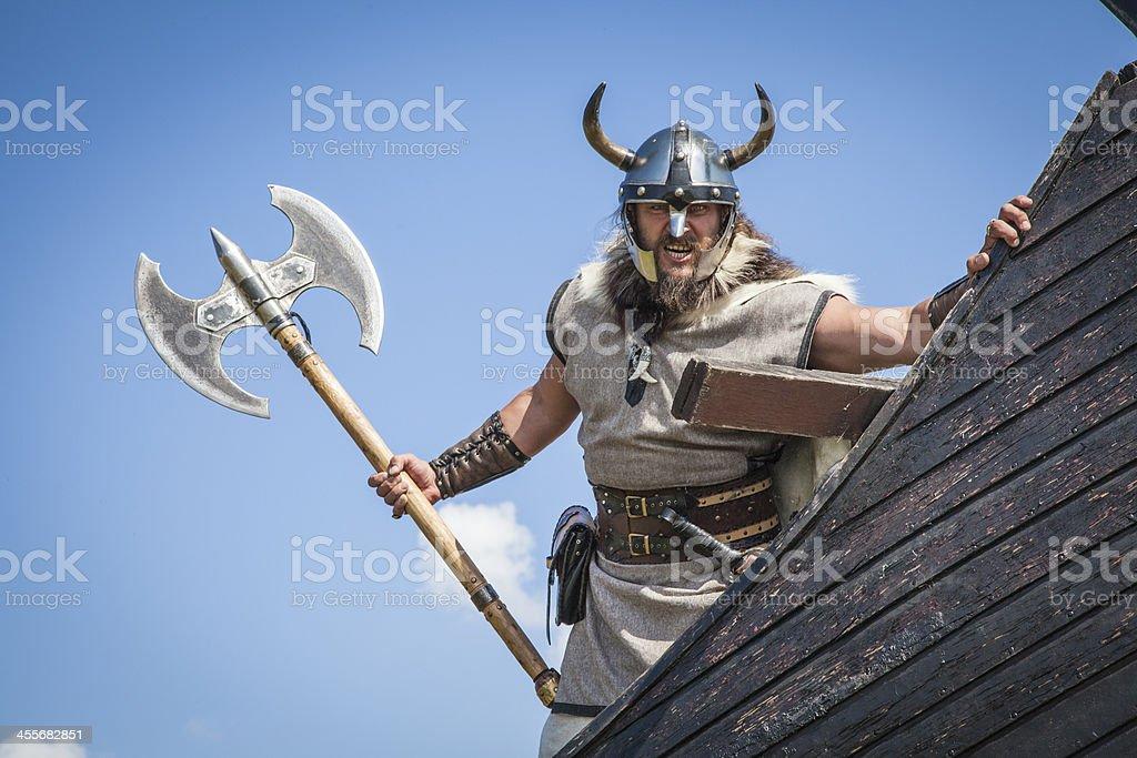 Strong angry Viking on his ship stock photo