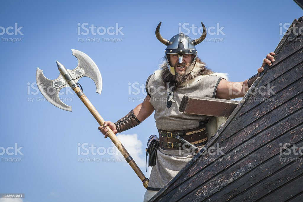 Strong angry Viking on his ship stock photo