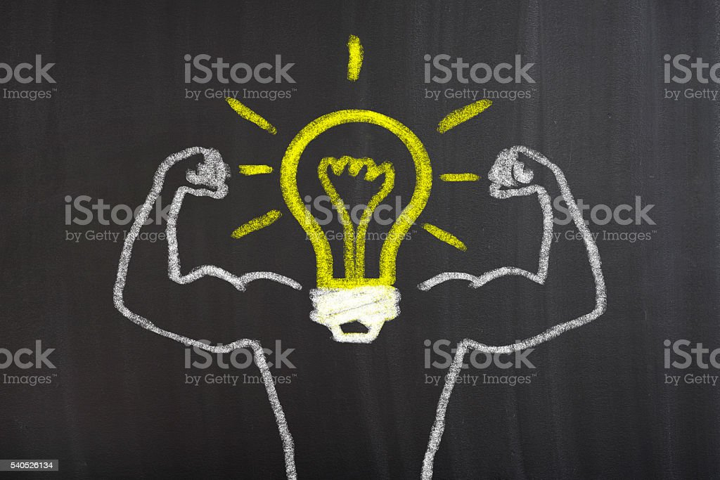 Strong Arms chalk drawing with light bulb stock photo