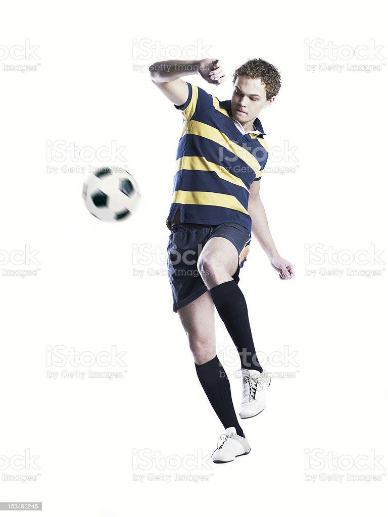 Strong athlete kicking the ball stock photo