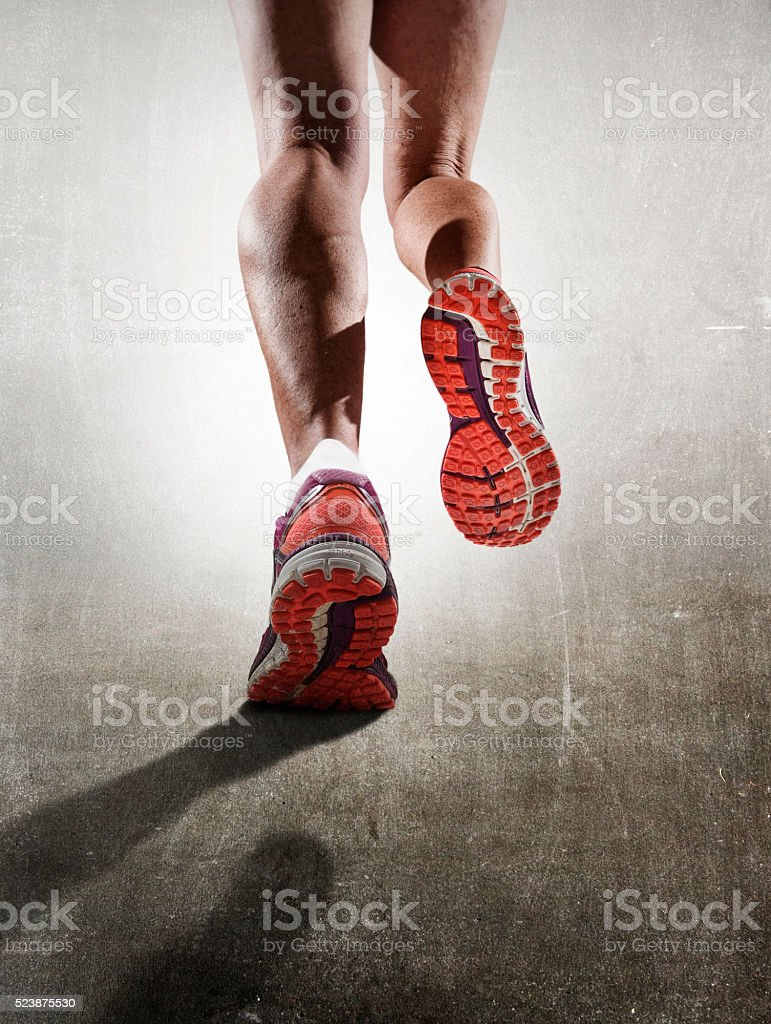 strong athletic female legs running shoes sport woman jogging stock photo