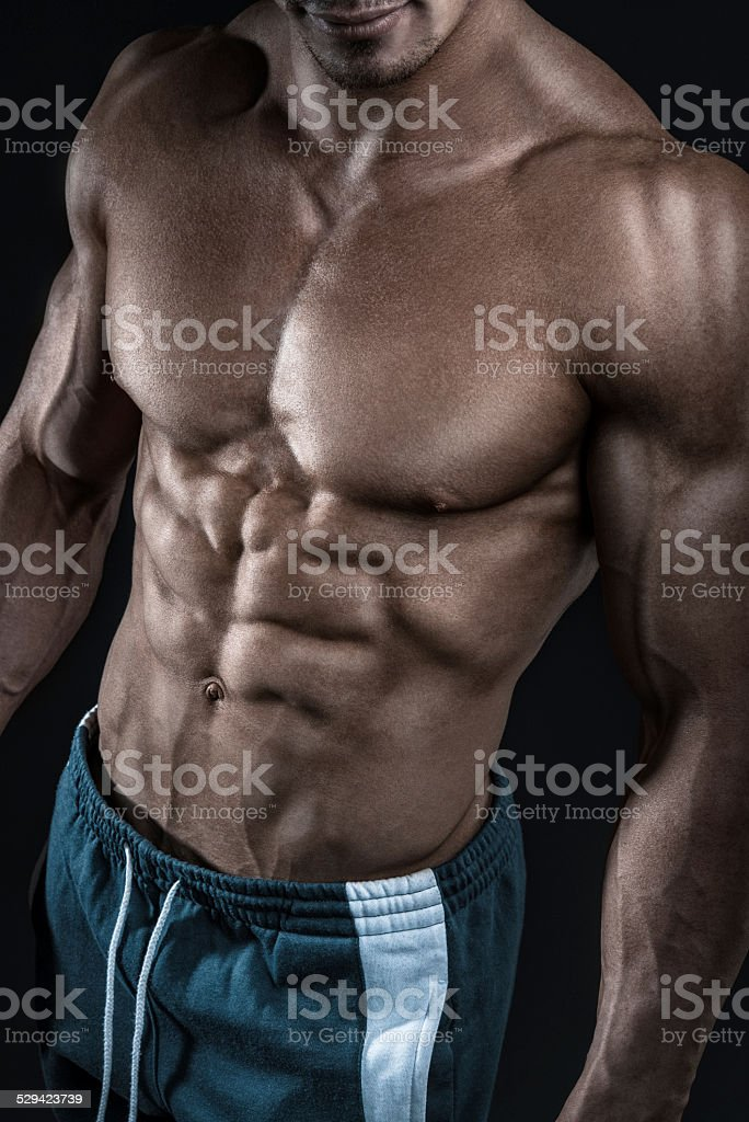 Strong athletic man fitness model showing torso muscles stock photo