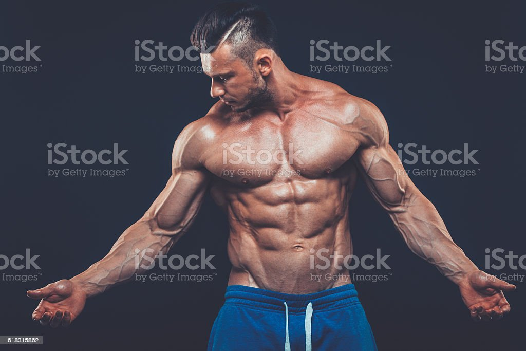 strong athletic man on black background stock photo