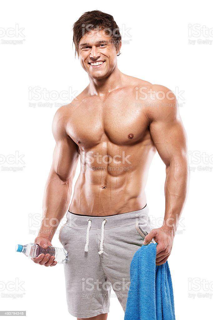 Strong Athletic Man  showing big biceps and abdominal muscles stock photo