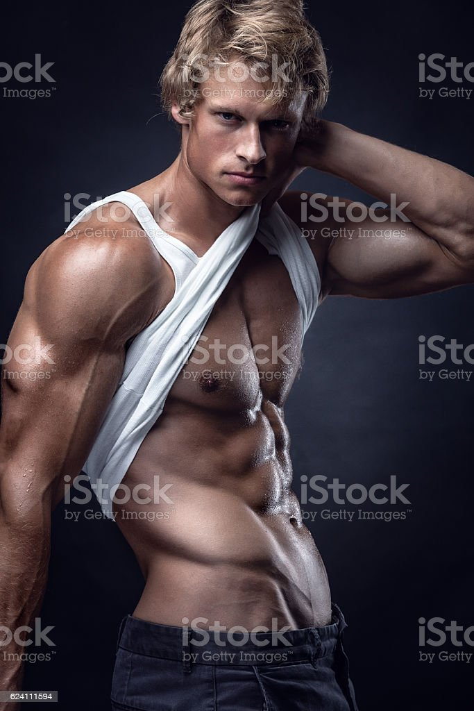 Strong Athletic Man shows body and abdominal muscles stock photo
