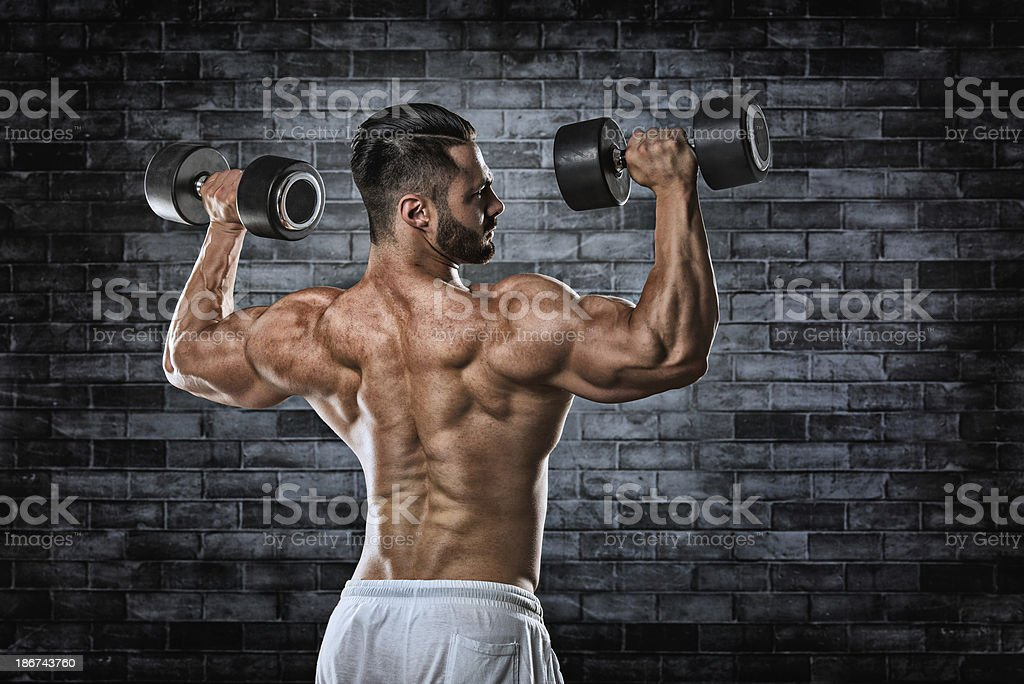 Strong back of male bodybuilder royalty-free stock photo