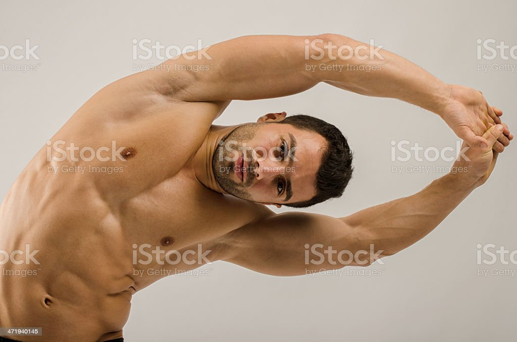 Strong bodybuilder training his six pack stock photo
