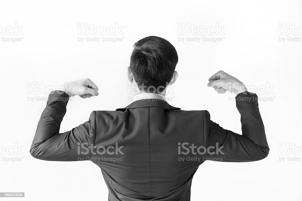 Strong businessman flexing his muscle for fight and motivation. stock photo
