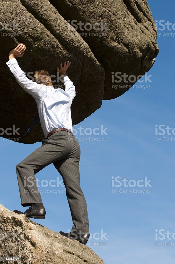 Strong Businessman Struggling Pushing Boulder Up royalty-free stock photo