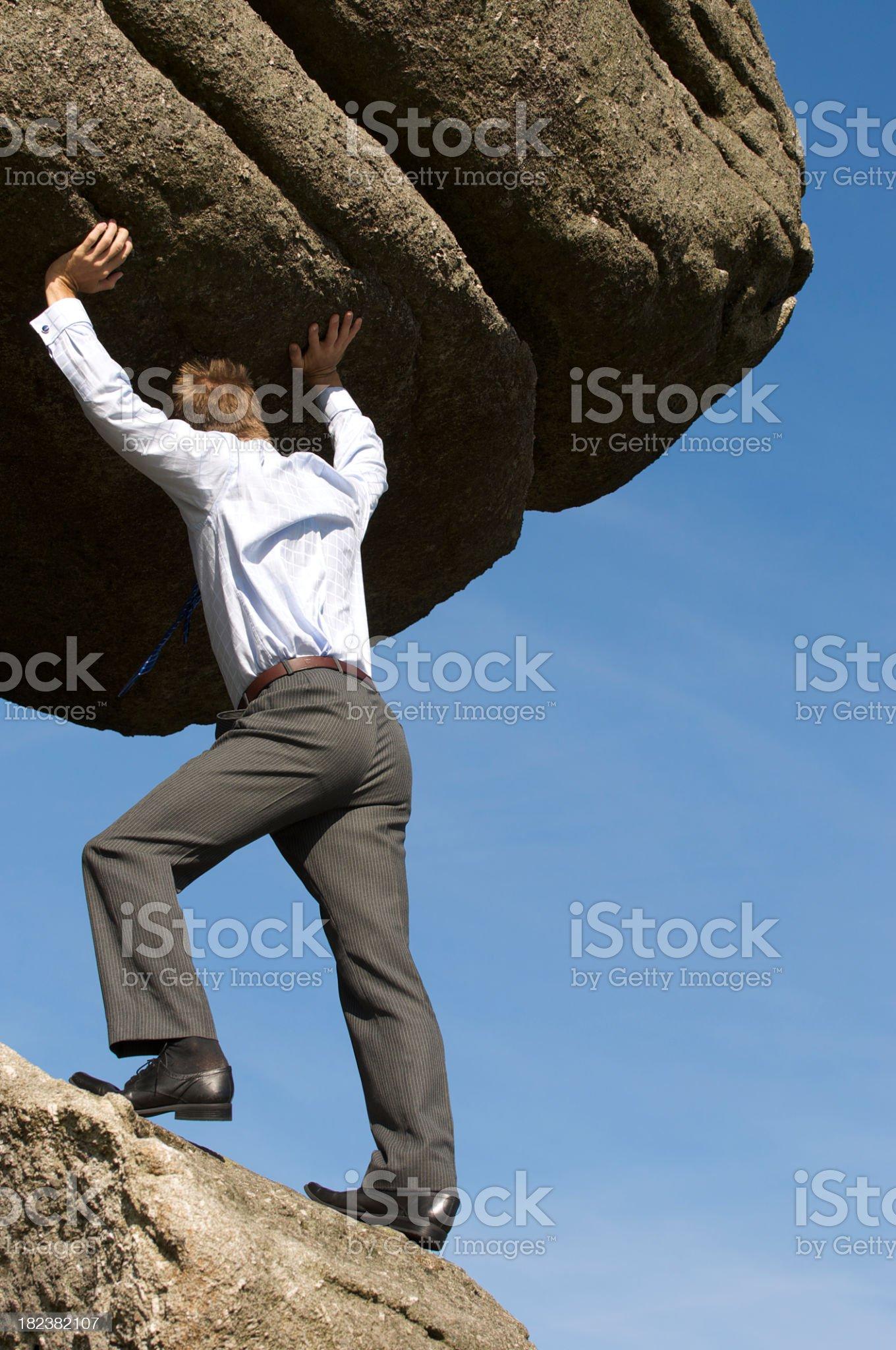 Strong Businessman Struggling Pushing Boulder Up royalty-free stock photo
