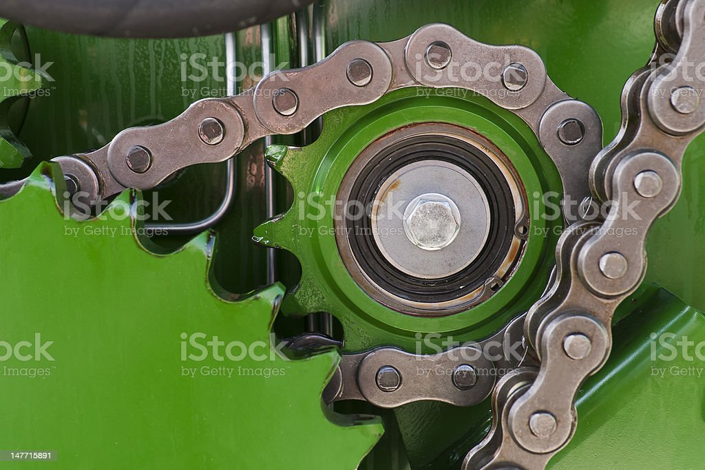 Strong chain on the machine in green stock photo