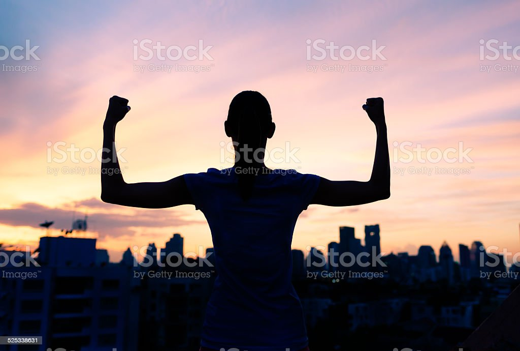 Strong confident woman in the city stock photo