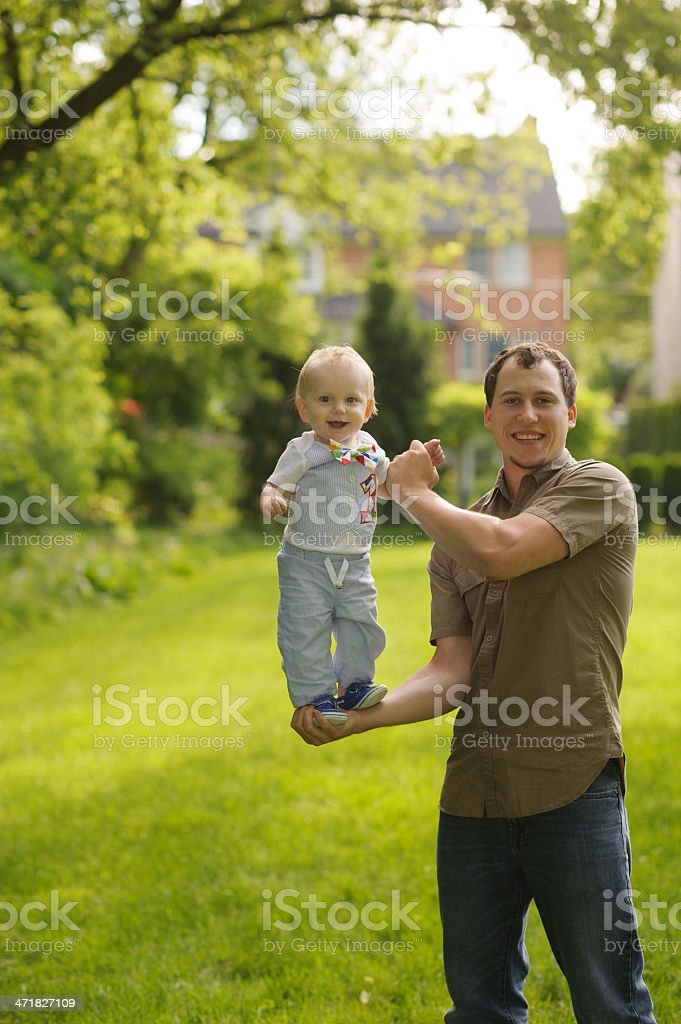 Strong Father Holding Son on Hand royalty-free stock photo