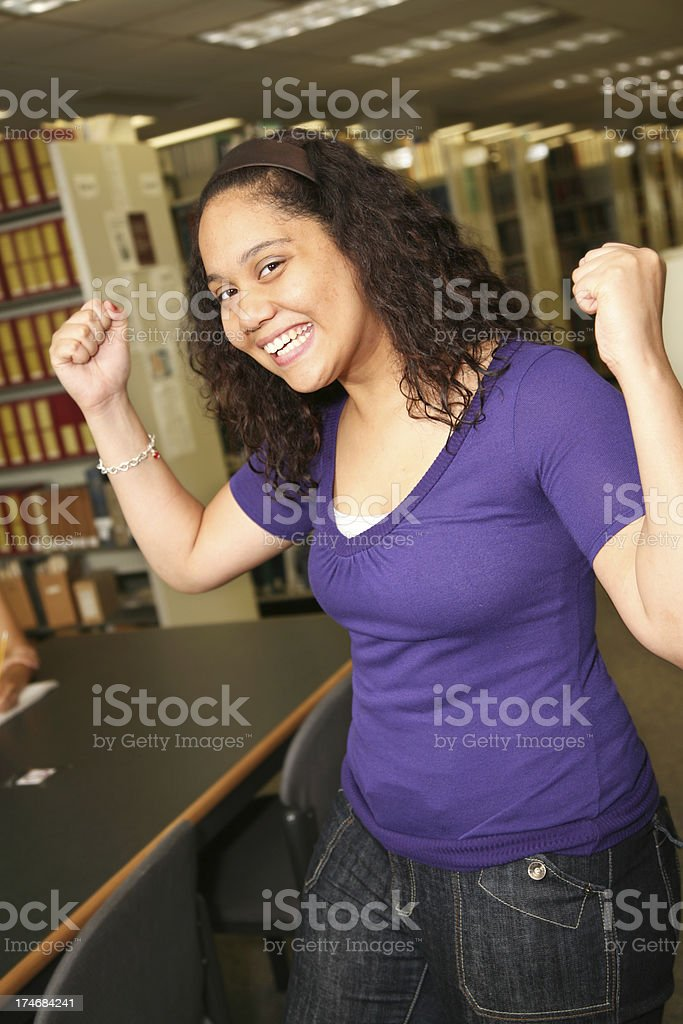 Strong Female College Student in the Library royalty-free stock photo