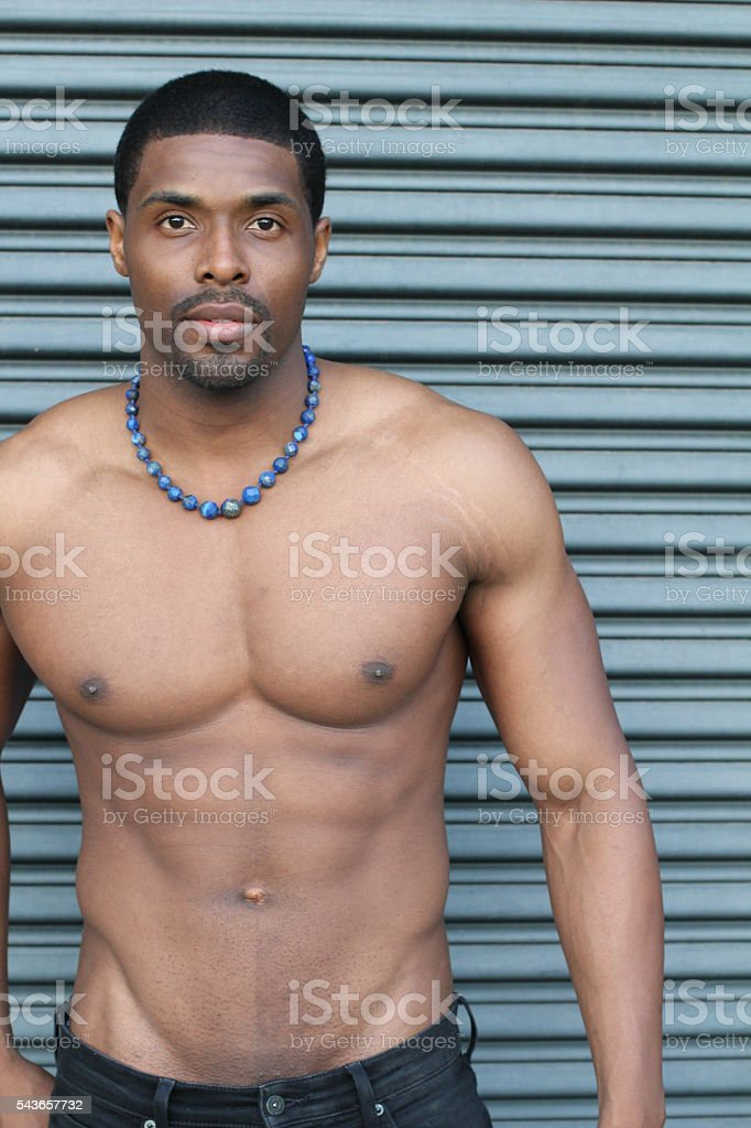 Strong, fit and sporty African man stock photo
