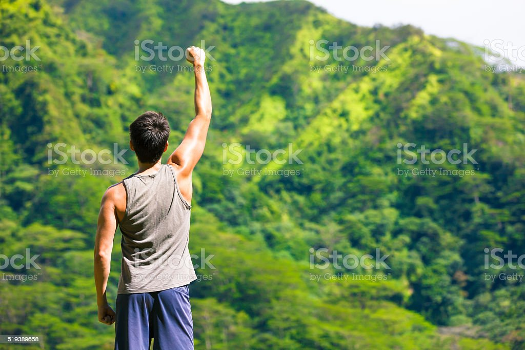 Strong fit male celebrating his success stock photo