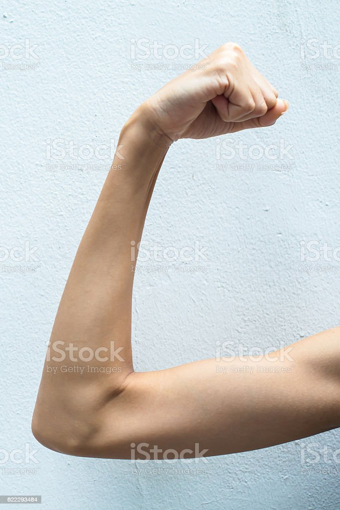 strong girl fit and firm thin arm stock photo