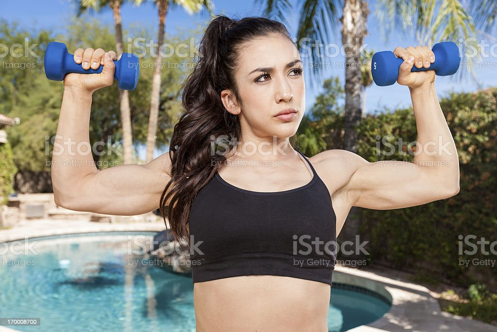 Strong Girl Flexing Arms royalty-free stock photo