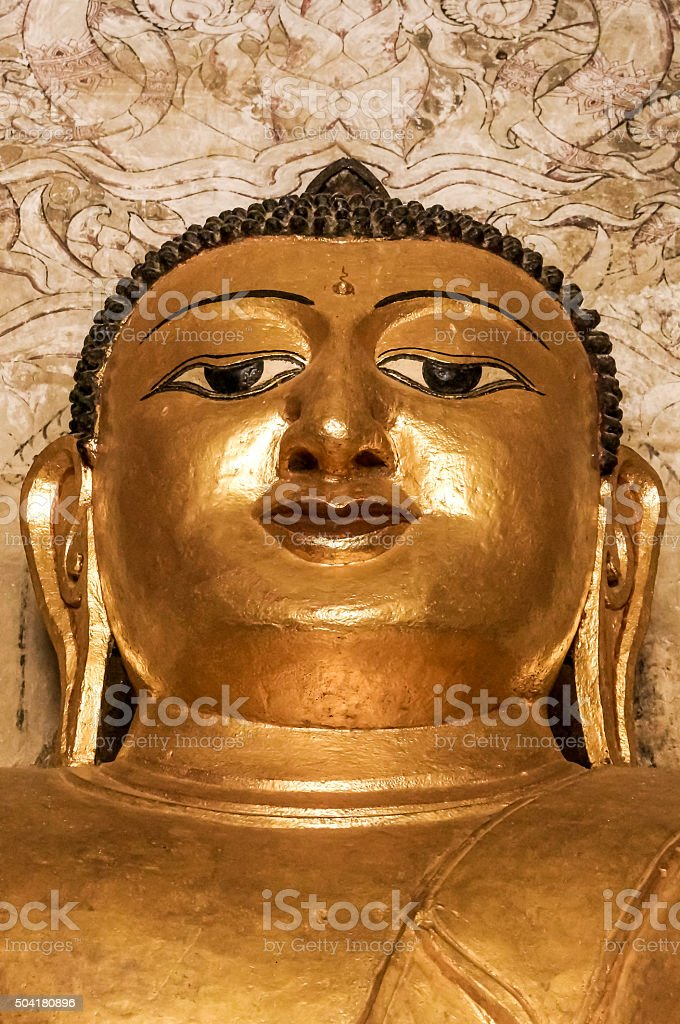 Strong golden meditating Buddha face with third eye Burma Myanmar stock photo
