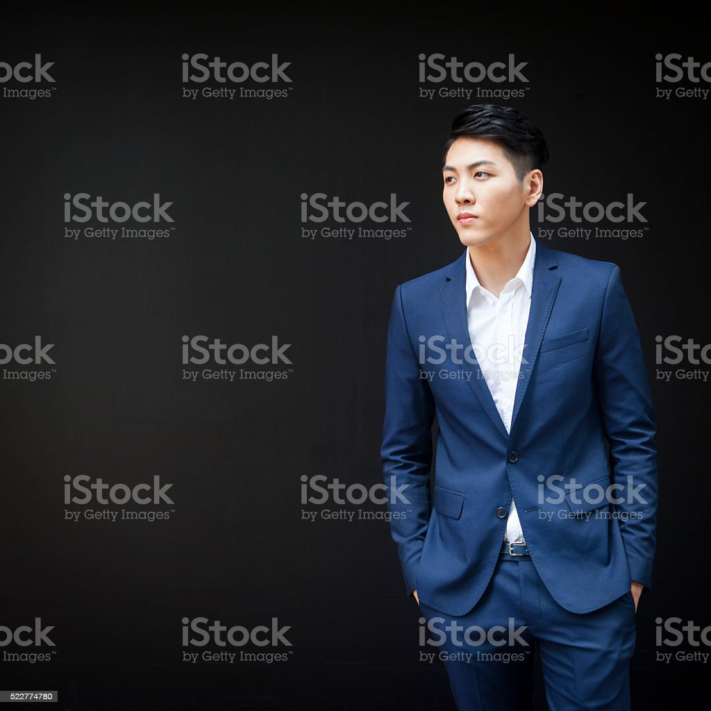 Strong Good Looking Asian Businessman With A Deep Look stock photo