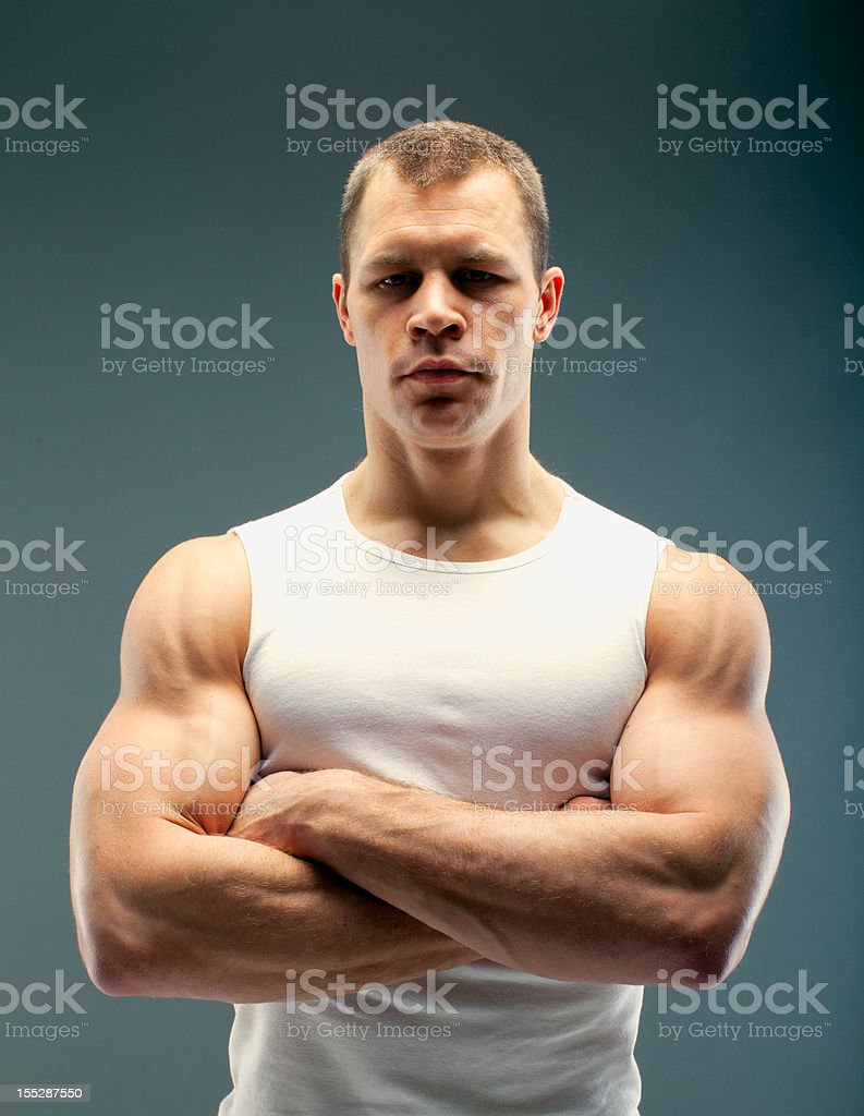 Strong guy with crossed arms stock photo