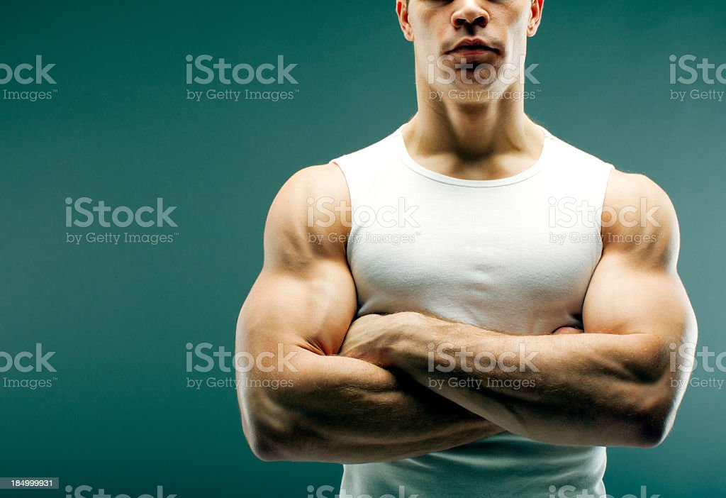 Strong guy with crossed arms royalty-free stock photo