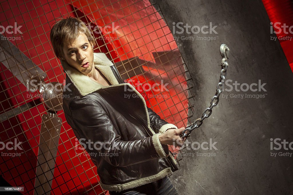 Strong guy with metal chain royalty-free stock photo