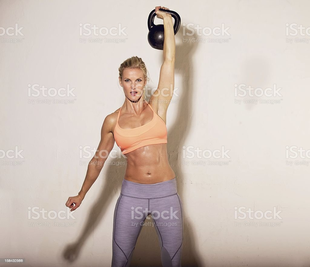 Strong gym Woman with a Kettlebell stock photo