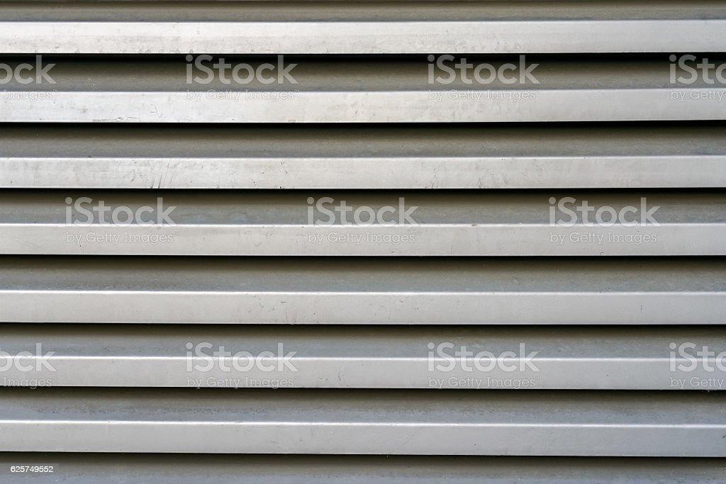 Strong hard and durable gray metal surface deep horizontal lines stock photo