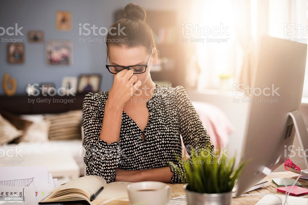 Strong headache during work at the office stock photo