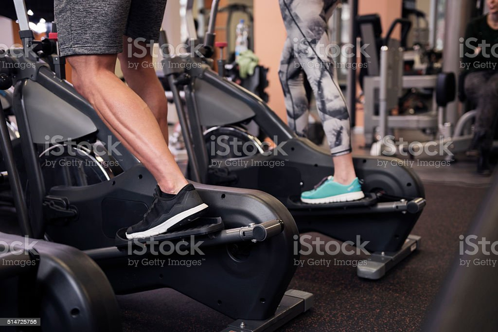 Strong legs of exercising couple stock photo