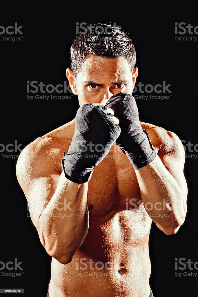 Strong male fighter with his gaurd up royalty-free stock photo