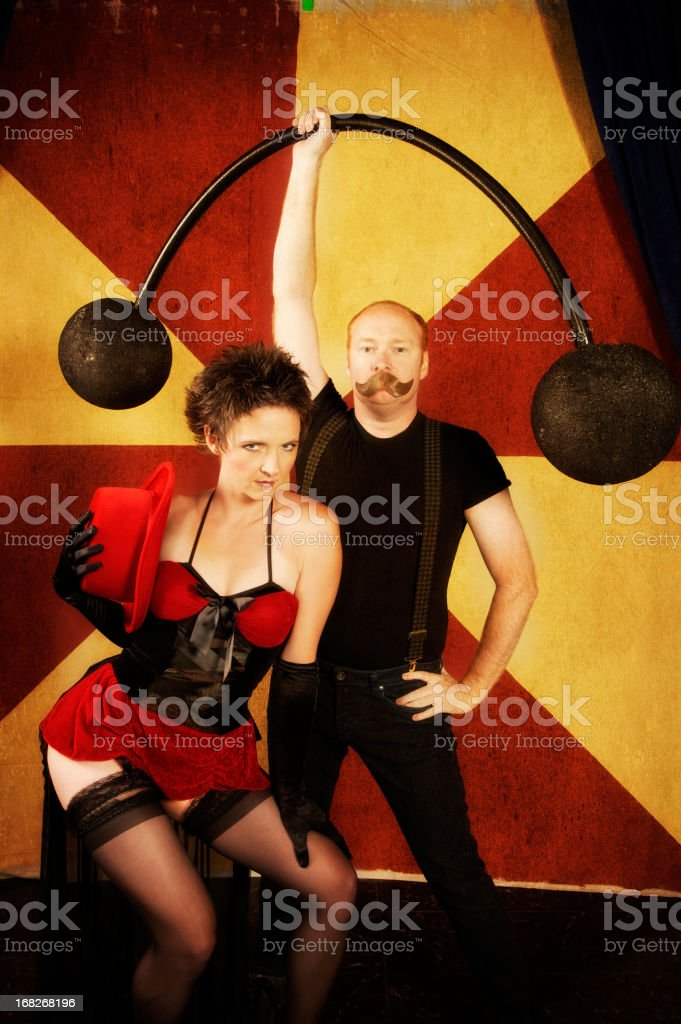 Strong Man and Sexy Woman with Retro Carnival Background stock photo