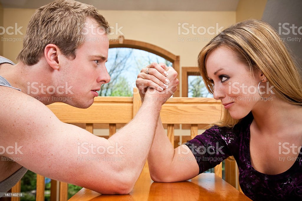 Strong Man and Small Woman Arm Wrestling royalty-free stock photo