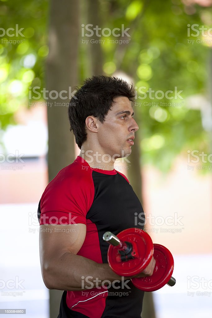 Strong man lifting weights royalty-free stock photo